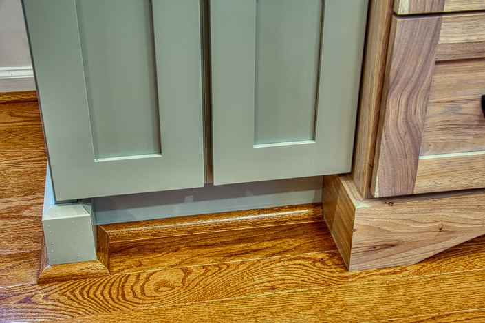 Kitchen remodel close up of how flooring came together with cabinetry