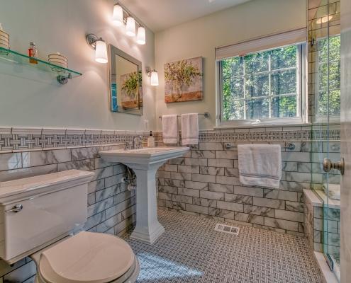 Falls Church Bathroom Remodel featuring basketweave Carrara marble tile