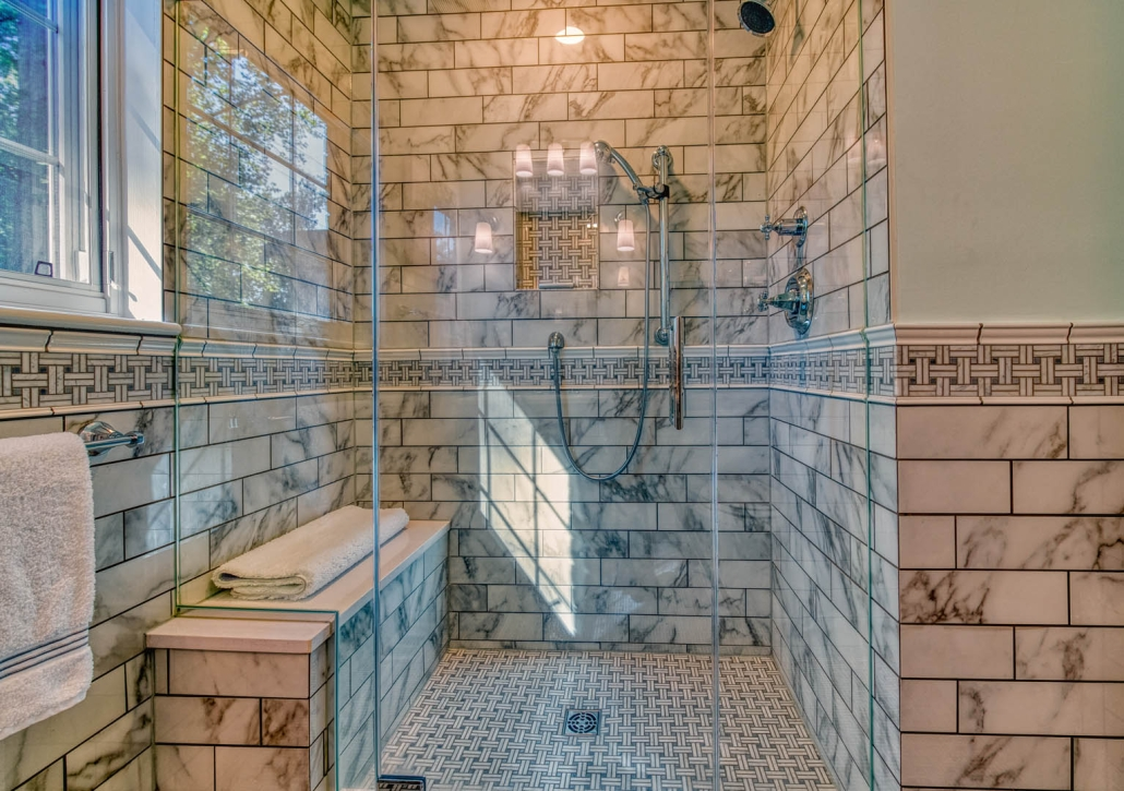 Falls Church Bathroom Remodel with Enchant Florida tile walls and Carrara Basketweave chair rail