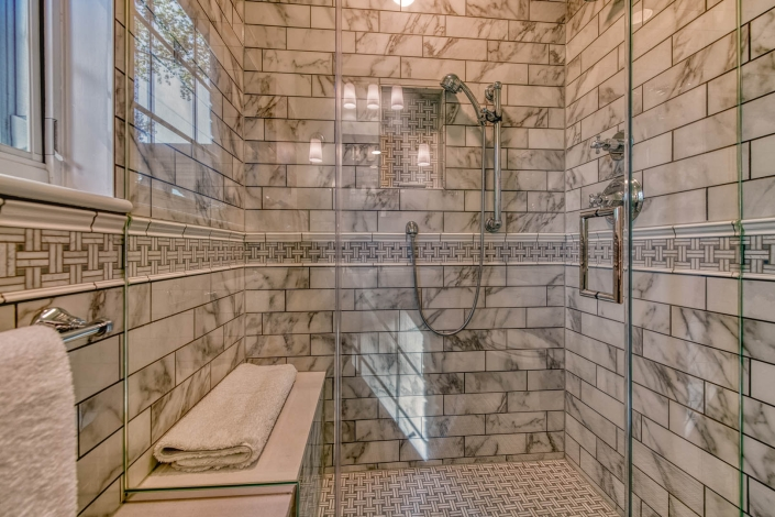 Marble shower in Falls Church bathroom remodel with Boca Raton shower hardware and Carrara marble bench seat