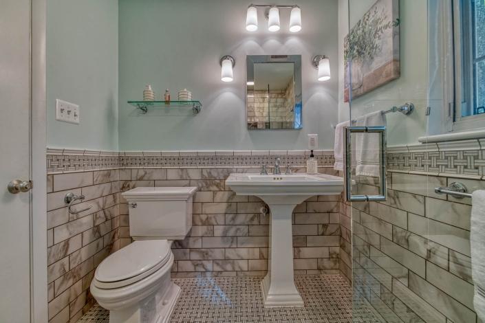 Falls Church bathroom remodel with Carrara marble chair rail and flooring