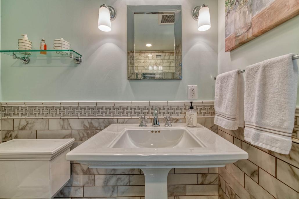 Falls Church bathroom remodel with Kohler Memoirs pedestal sink and Carrara marble basketweave backsplash