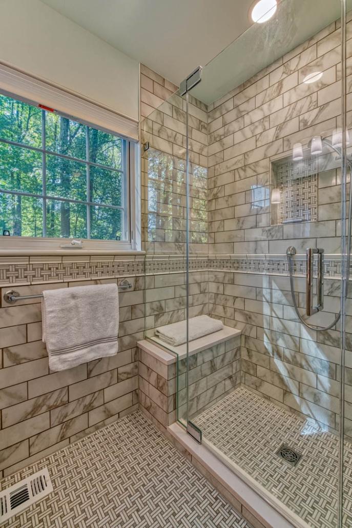 Glass shower in Falls Church bathroom remodel featuring Carrara marble