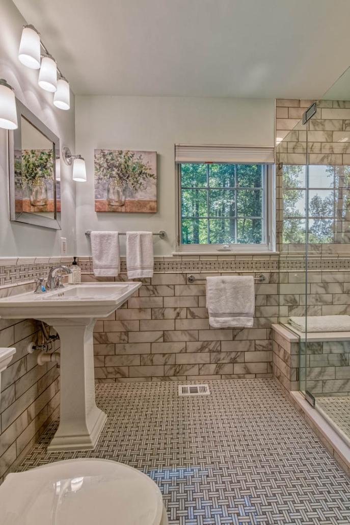Carrara marble Falls Church bathroom remodel with Kohler toilet and sink