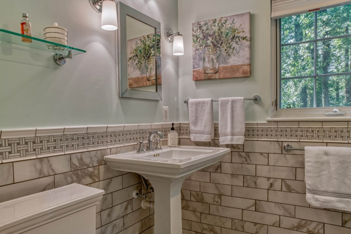 Falls Church bathroom remodel with basketweave Carrara marble tile on chair rail and walls