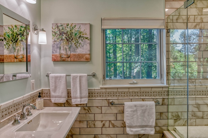 Falls Church bathroom remodel with window, vanity and glass shower