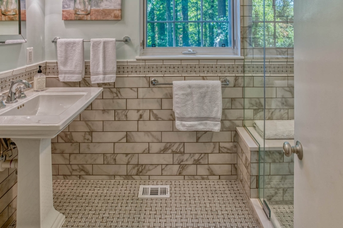 Bathroom Remodel in Falls Church featuring Carrara marble with basketweave pattern
